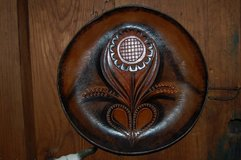 Leather wall art/plate in Kingwood, Texas